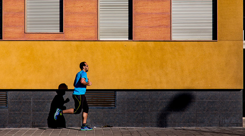 man running on street - 5 Health Benefits of Running That'll Motivate you to Get Started