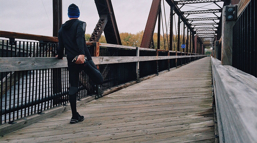 man warming up - 5 Health Benefits of Running That'll Motivate you to Get Started